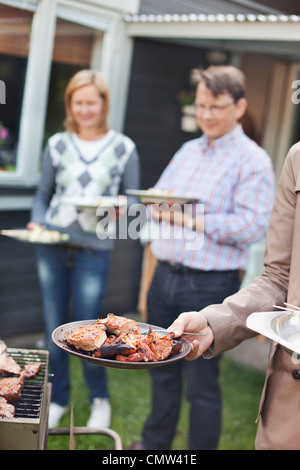 Mature couple at barbecue party - Stock Photo