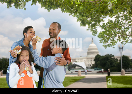 African American family eating hot dogs on vacation - Stock Photo