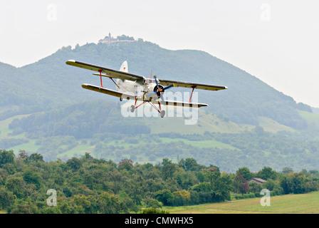 """1975"" Antonov An-2 landing approach at the Hahnweide vintage air show, Kirchheim-Teck, Germany - Stock Photo"