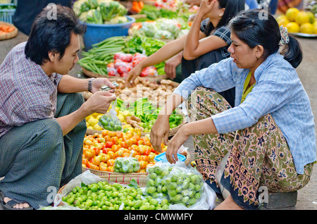 Busy street market in Central Yangon, Myanmar - Stock Photo