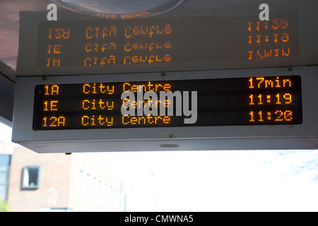 bus tracking system bustrak on a bus shelter stop in Belfast Northern Ireland uk - Stock Photo