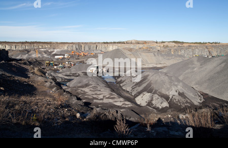 Machinery at the bottom of a rock quarry where rock is processed to gravel and macadam , Finland - Stock Photo