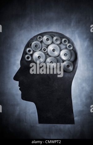 Conceptual image of head filled with cog gears. - Stock Photo