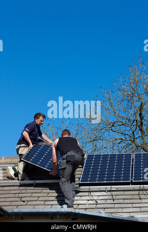 Solar panel installation on a roof - Stock Photo