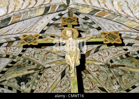 Crucifix and 15th century ceiling paintings in the Church of St. Lawrence in Pernio, Finland - Stock Photo