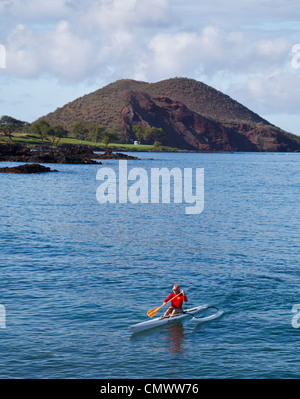 One-person outrigger canoe approaching Makena Landing on Maui - Stock Photo