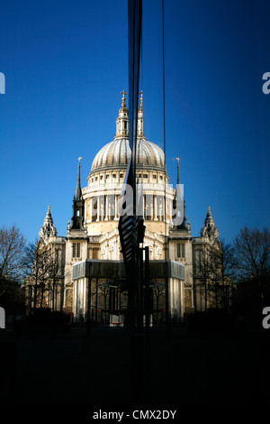 St Paul's Cathedral reflected in the glass front of Jamie Oliver's Barbecoa restaurant in New Change, City of London, - Stock Photo