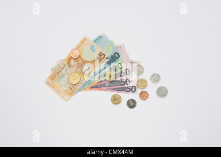 Notes and coins on white background - Stock Photo