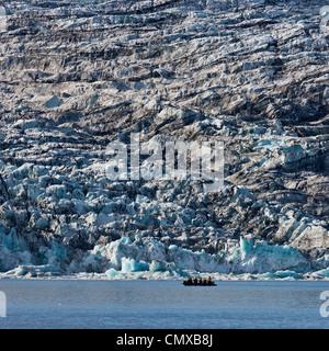 Zodiac Boat tour on the Jokulsarlon Glacial Lagoon, Breidamerkurjokull glacier, Vatnajokull Ice Cap, Iceland - Stock Photo