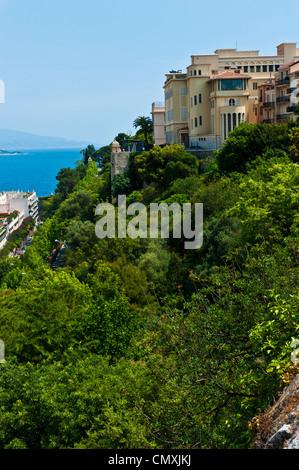 Long shot of Monaco estate on hills over the coastline of the Mediterranean Sea. - Stock Photo