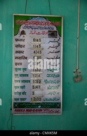 Prayer Times, Madrasa Imdadul Uloom, Dehradun, India. - Stock Photo