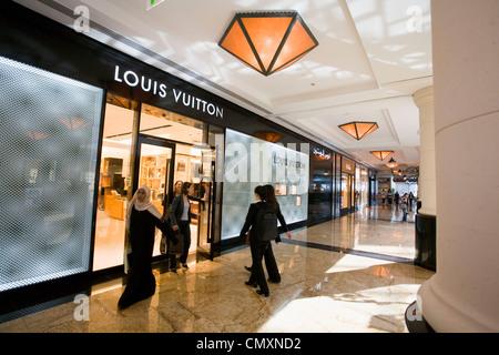 Dubai Mall of Emirates shopping mall Louis Viutton, arab women - Stock Photo