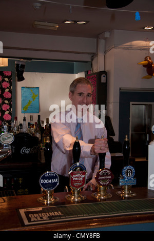 Greg Mullholland MP , pulling a pint of local beer - Stock Photo