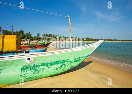 Outrigger fishing boats on this popular surf beach, badly hit by the 2004 tsunami; Arugam Bay, Eastern Province, - Stock Photo