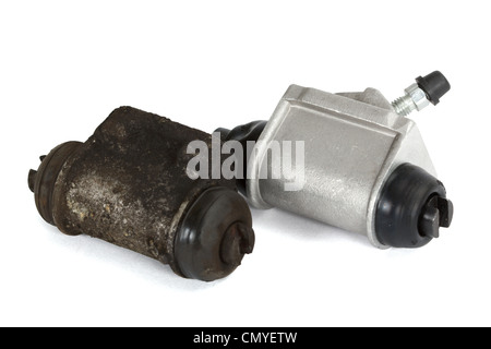 Old and new hydraulic cylinders brake, isolated on a white background - Stock Photo