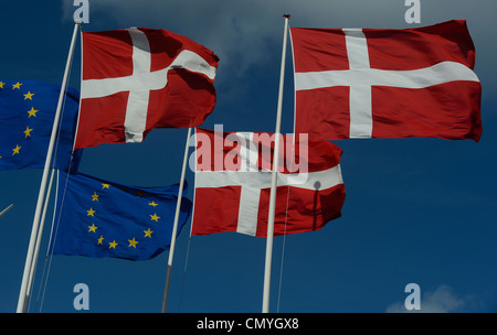 Danish and EU  flags are pictured in Copenhagen, Denmark, March 30, 2012. - Stock Photo