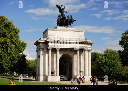 United Kingdom, London, Hyde Park Corner, Wellington Arch is a Triumphal Arch commissioned by King George IV in - Stock Photo