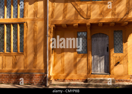 Little Hall, a mustard yellow coloured medieval Tudor building in Lavenham, Suffolk - Stock Photo