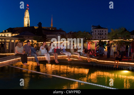Switzerland Zurich, bare foot bar at river Limmat at night. background Grossmunster - Stock Photo