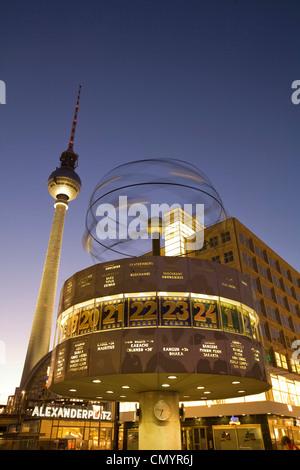Alexanderplatz world clock TV tower at night in Berlin - Stock Photo