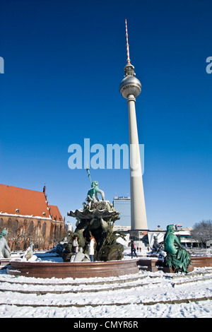 snow at Neptun fountain in front of Alex in Berlin center - Stock Photo