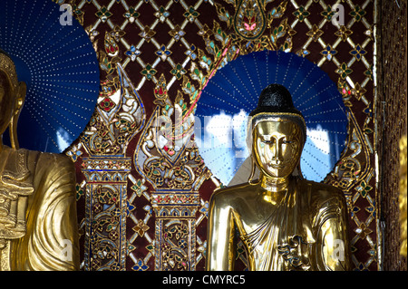 Two statues at the Shwedagon pagoda in Yangon Myanmar - Stock Photo