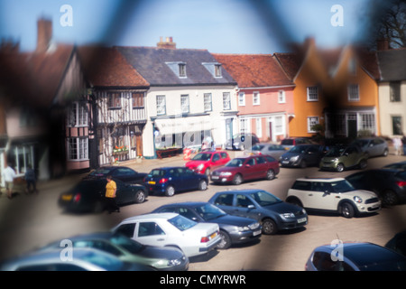 View of Lavenham Market Place through the medieval window of the Guildhall, Lavenham, Suffolk - Stock Photo