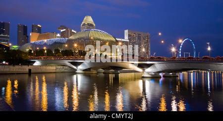 Skyline of Singapur, Esplanade, Marina Square, big wheel at twilight, South East Asia, twilight - Stock Photo