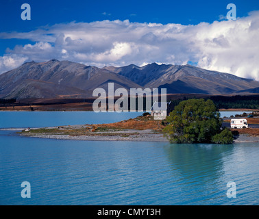 Camper Van near little church of the good Sherpard at Lake Tekapo in South Island of New Zealand - Stock Photo