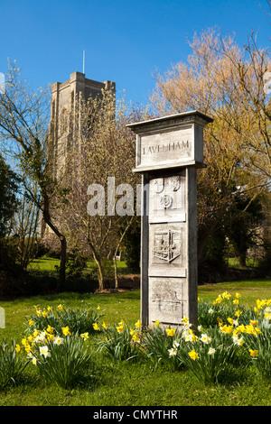 Lavenham village sign by St Peter and St Paul's Church, Lavenham, Suffolk, UK - Stock Photo