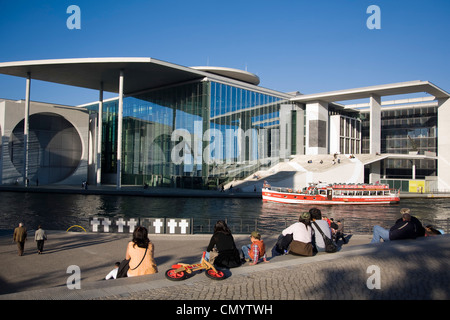 Berlin, government district, Elisabeth Lueders building, Spree, tour boat, people - Stock Photo