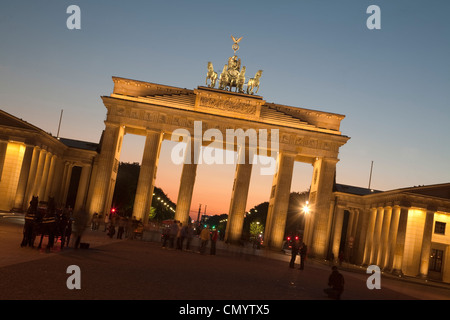 Brandenburg gate with Quadriga on top of in Berlin at sunset - Stock Photo