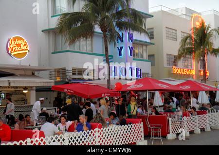 Miami Beach Florida Ocean Drive Art Deco Historic District hotels restaurant alfresco dining umbrellas Johnny Rockets - Stock Photo
