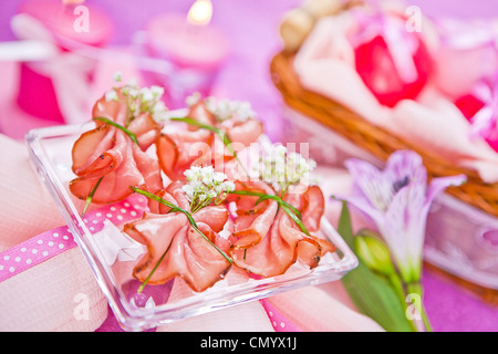 decorated piece of ham on the table - Stock Photo