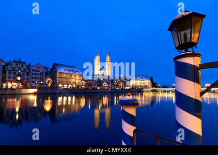 Pier at the Hotel Storchen, old town center, river Limmat at night, Limmatquai Grossmunster, Zurich, Switzerland - Stock Photo