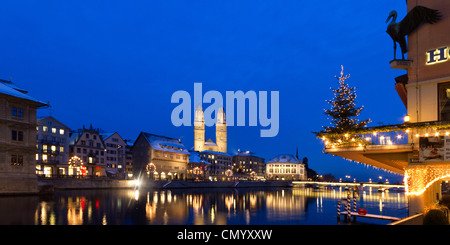 Hotel Storchen, old town center, river Limmat at night, Limmatquai Grossmunster, Zurich, Switzerland - Stock Photo