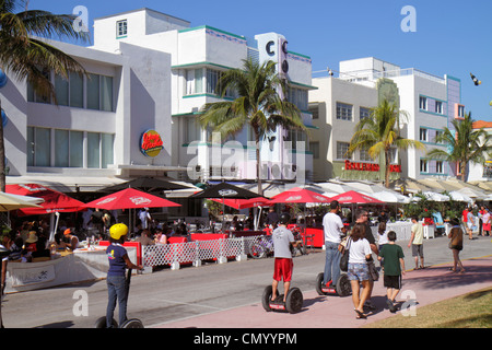 Miami Beach Florida Ocean Drive Art Deco Historic District Boulevard Colony Hotel alfresco dining umbrellas restaurant - Stock Photo