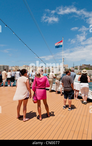 The deck of the cruise ship with passengers while approaching port in San Juan, Puerto Rico on a beautiful Caribbean - Stock Photo