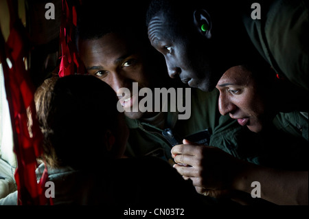 U.S. Air Force Academy Cadets (left) Jerell Alexander, (center) Joseph Abakunda and Andre Ball look out the window - Stock Photo