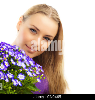 Beautiful female holding flowers, girl with bouquet of spring plant, bunch of purple cornflowers, lovely woman with - Stock Photo