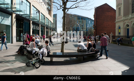 People relaxing in the St Davids 2 Shopping Precinct in early spring Cardiff South Wales UK  KATHY DEWITT - Stock Photo