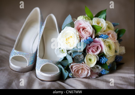wedding shoes and bride's flowers - Stock Photo