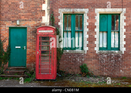 Disused railway station building and phone box, Seaton Junction, Devon - Stock Photo