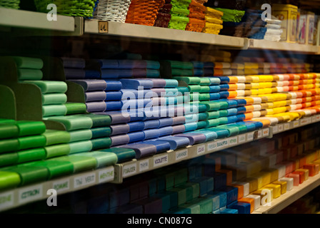 rows of soap for sale in a french shop - Stock Photo