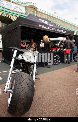 England, East Sussex, Brighton, Stall selling motorcycle accessories during bike festival on Madeira Drive. - Stock Photo