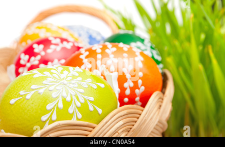 Easter Hand Painted Eggs in Basket With Grass in Background - Stock Photo