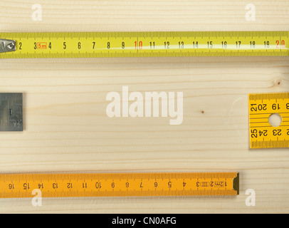 Rulers on a wooden background. - Stock Photo