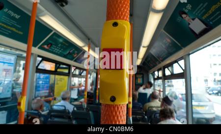 Stop button on an Arriva passenger bus Cardiff UK - Stock Photo
