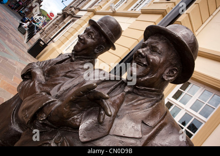 UK, England, Cumbria, Ulverston, Statue of Stan Laurel and Oliver Hardy outside outside Coronation Hall theatre - Stock Photo