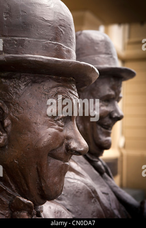 UK, Cumbria, Ulverston, Statue of Stan Laurel and Oliver Hardy outside Coronation Hall theatre - Stock Photo